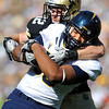 "Cal's Anthony Miller, 80, fights off CU's Patrick Mahnke, 12, for a touchdown catch and run during their game at Folsom Field in Boulder.<br /> For more photos of the CU game, go to  <a href=""http://www.dailycamera.com"">http://www.dailycamera.com</a>.<br /> Paul Aiken / September 10, 2011 / The Daily Camera"