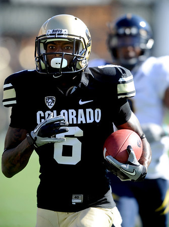 "Paul Richardson of CU takes off with his first long touchdown  against California on Saturday.<br /> For more photos of the CU game, go to  <a href=""http://www.dailycamera.com"">http://www.dailycamera.com</a>.<br /> Cliff Grassmick / September 10, 2011"