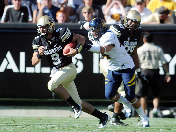 """CU QB Tyler Hansen avoids the Cal pass rush.<br /> For more photos of the CU game, go to  <a href=""""http://www.dailycamera.com"""">http://www.dailycamera.com</a>.<br /> Cliff Grassmick / September 10, 2011"""