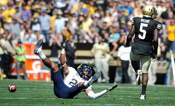"Cal's Kennan Allen, 21, calls for pass interference against CU's Derrick Webb, 5, during their game at Folsom Field on Saturday September 10, 2011. <br /> FOR MORE PHOTOS FROM THE GAME GO TO  <a href=""http://WWW.DAILYCAMERA.COM"">http://WWW.DAILYCAMERA.COM</a><br /> Photo by Paul Aiken / The Camera / September 10 2011"