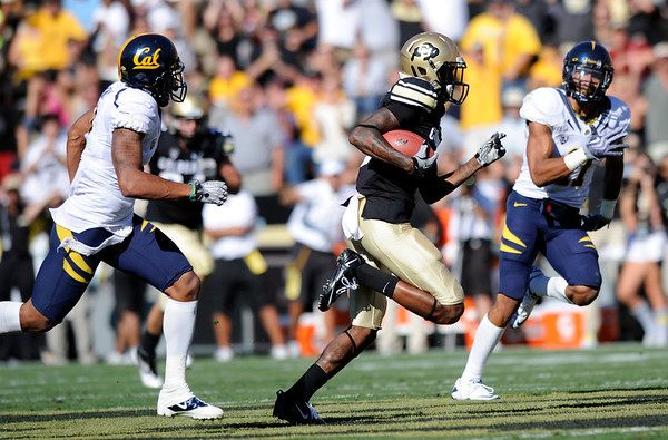 "CU""s Paul Richardson, 6, breaks away for a touchdown catch and run as Cal's defenders Marc Anthony, 2, and SEan Catouse, 11, give chase during their game at Folsom Field in Boulder.<br /> For more photos of the CU game, go to  <a href=""http://www.dailycamera.com"">http://www.dailycamera.com</a>.<br /> Paul Aiken / September 10, 2011 / The Daily Camera"