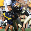 "CU'S Josh Hartigan 17, puts a hard hit on CAl Quarterback Zack Maynard, 15, during their game at Folsom Field in Boulder.<br /> For more photos of the CU game, go to  <a href=""http://www.dailycamera.com"">http://www.dailycamera.com</a>.<br /> Paul Aiken / September 10, 2011 / The Daily Camera"