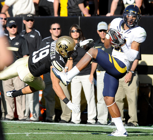 "Cal's Keenan Allen, 21, makes a clutch catch over Travis Sandersfeld, 19, late in the game at Folsom Field in Boulder.<br /> For more photos of the CU game, go to  <a href=""http://www.dailycamera.com"">http://www.dailycamera.com</a>.<br /> Paul Aiken / September 10, 2011 / The Daily Camera"