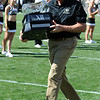 "Former CU head coach Gary Barnett runs the 2001 BIG 12 trophy over to that team during halftime.<br /> For more photos of the CU game, go to  <a href=""http://www.dailycamera.com"">http://www.dailycamera.com</a>.<br /> Cliff Grassmick / September 10, 2011"