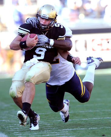 "CU'S Tyler Hansen is run down by Cal's Ryan Davis late in the game at Folsom Field in Boulder.<br /> For more photos of the CU game, go to  <a href=""http://www.dailycamera.com"">http://www.dailycamera.com</a>.<br /> Paul Aiken / September 10, 2011 / The Daily Camera"