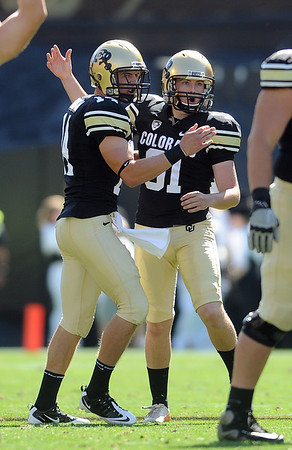 """Will Oliver (91) of CU is congratulated by John Schrock after hitting a 50-plus field goal against Cal.<br /> For more photos of the CU game, go to  <a href=""""http://www.dailycamera.com"""">http://www.dailycamera.com</a>.<br /> Cliff Grassmick / September 10, 2011"""