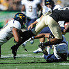 "CU'S Paul Richardson, 6, fights off Cal's tacklers Robert Mullins, 37 and C.J. Moncrease, 8,  during their game at Folsom Field in Boulder.<br /> For more photos of the CU game, go to  <a href=""http://www.dailycamera.com"">http://www.dailycamera.com</a>.<br /> Paul Aiken / September 10, 2011 / The Daily Camera"