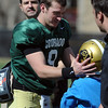 "Tyler Hansen gets his helmet back from Eduardo Jimenez, 9, after the scrimmage.<br /> For more photos and a video of Embree, go to  <a href=""http://www.dailycamera.com"">http://www.dailycamera.com</a>.<br /> Cliff Grassmick/ April 2, 2011"