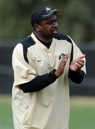 """Colorado football coach, Jon Embree, works with the team during the scrimmage on Saturday.<br /> For more photos and a video of Embree, go to  <a href=""""http://www.dailycamera.com"""">http://www.dailycamera.com</a>.<br /> Cliff Grassmick/ April 2, 2011"""