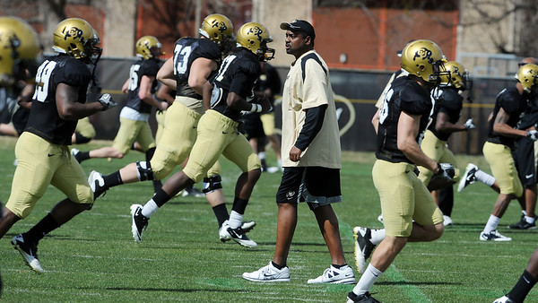 "Colorado football coach, Jon Embree, works with the team during the scrimmage on Saturday.<br /> For more photos and a video of Embree, go to  <a href=""http://www.dailycamera.com"">http://www.dailycamera.com</a>.<br /> Cliff Grassmick/ April 2, 2011"