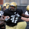 "Josh Ford pulls away from a defender during the scrimmage on Saturday.<br /> For more photos and a video of Embree, go to  <a href=""http://www.dailycamera.com"">http://www.dailycamera.com</a>.<br /> Cliff Grassmick/ April 2, 2011"