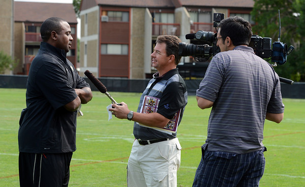 "CU coach Jon Embree talks to an Oregon TV station on Thursday.<br /> For a video and more photos of CU football, go to  <a href=""http://www.dailycamera.com"">http://www.dailycamera.com</a>.<br /> Cliff Grassmick  / August 16, 2012"