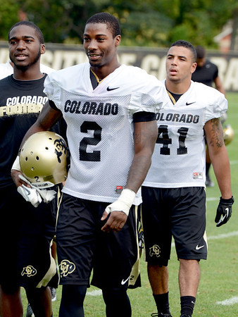 "Kenneth Crawley (2) and Terrel Smith (41) finish up practice on Thursday.<br /> For a video and more photos of CU football, go to  <a href=""http://www.dailycamera.com"">http://www.dailycamera.com</a>.<br /> Cliff Grassmick  / August 16, 2012"