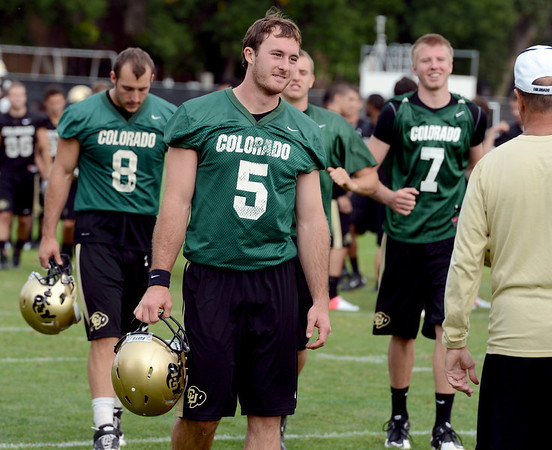 "Connor Wood (5) joins other CU QB's after practice on Thursday.<br /> For a video and more photos of CU football, go to  <a href=""http://www.dailycamera.com"">http://www.dailycamera.com</a>.<br /> Cliff Grassmick  / August 16, 2012"