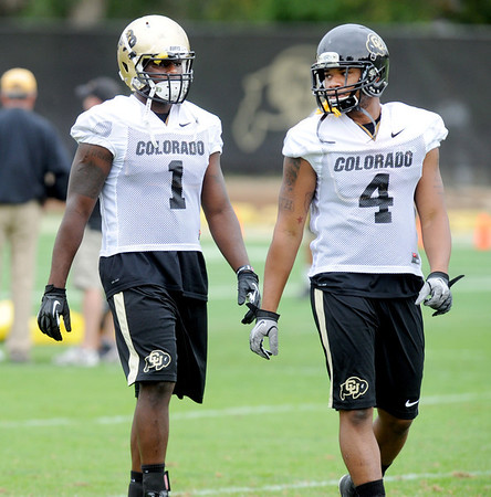 "Derrick Webb, left, and Kyle Washington during CU football practice on Thursday.<br /> For more photos and videos of practice,  go to  <a href=""http://www.dailycamera.com"">http://www.dailycamera.com</a>.<br /> Cliff Grassmick / August 16, 2012"