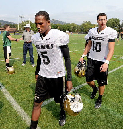 "Yuri Wright, left,  and Isaac Archuleta (10), finish up practice on Thursday.<br /> For a video and more photos of CU football, go to  <a href=""http://www.dailycamera.com"">http://www.dailycamera.com</a>.<br /> Cliff Grassmick  / August 16, 2012"