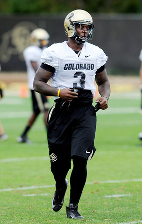 "Doug Rippy works during  CU football practice on August 16, 2012.<br /> For more photos and videos of practice,  go to  <a href=""http://www.dailycamera.com"">http://www.dailycamera.com</a>.<br /> Cliff Grassmick / August 16, 2012"