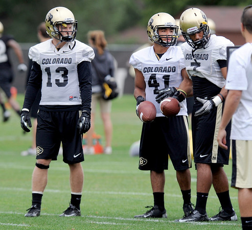 """Parker Orms, left, Terrel Smith and Ray Polk during CU football practice on Thursday.<br /> For more photos and videos of practice,  go to  <a href=""""http://www.dailycamera.com"""">http://www.dailycamera.com</a>.<br /> Cliff Grassmick / August 16, 2012"""