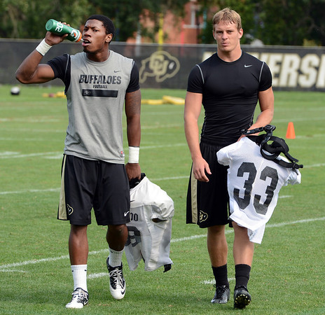 "Josh Moten, left, and Richard Yates, finish practice on Thursday.<br /> For a video and more photos of CU football, go to  <a href=""http://www.dailycamera.com"">http://www.dailycamera.com</a>.<br /> Cliff Grassmick  / August 16, 2012"