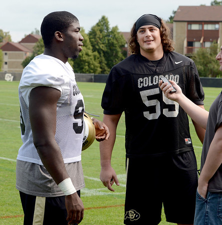 "Chidera Uzo-Diribe, left, and David Bakhtiari, talk to the media on Thursday.<br /> For a video and more photos of CU football, go to  <a href=""http://www.dailycamera.com"">http://www.dailycamera.com</a>.<br /> Cliff Grassmick  / August 16, 2012"