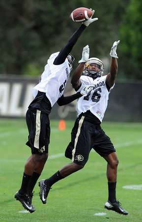 """Yuri Wright, left, knocks the ball from Jeffery Hall during CU football drills on Thursday.<br /> For more photos and videos of practice,  go to  <a href=""""http://www.dailycamera.com"""">http://www.dailycamera.com</a>.<br /> Cliff Grassmick / August 16, 2012"""