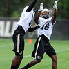 "Yuri Wright, left, knocks the ball from Jeffery Hall during CU football drills on Thursday.<br /> For more photos and videos of practice,  go to  <a href=""http://www.dailycamera.com"">http://www.dailycamera.com</a>.<br /> Cliff Grassmick / August 16, 2012"