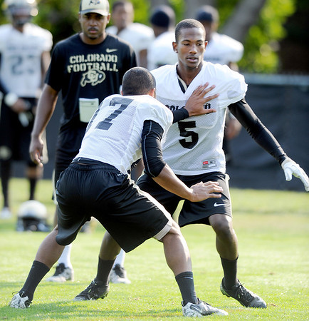 "DB Yuri Wright (5) works against Marques Mosley at practice on Aug. 17, 2012.<br /> For more photos and videos of practice,  go to  <a href=""http://www.dailycamera.com"">http://www.dailycamera.com</a>.<br /> Cliff Grassmick / August 17, 2012"