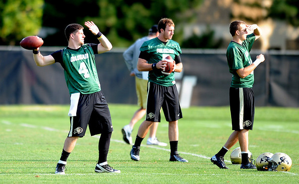 """CU QB's, Jordan Webb, left, Connor Wood, and Stevie Joe Dorman at practice on Aug. 17, 2012.<br /> For more photos and videos of practice,  go to  <a href=""""http://www.dailycamera.com"""">http://www.dailycamera.com</a>.<br /> Cliff Grassmick / August 17, 2012"""