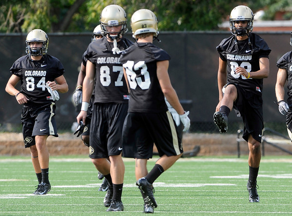 "University of Colorado's Jarrod Darden, at right, warms up during the second football practice of the fall camp on Tuesday, Aug. 7, at the CU practice field in Boulder. For more photos of the practice go to  <a href=""http://www.dailycamera.com"">http://www.dailycamera.com</a><br /> Jeremy Papasso/ Camera"