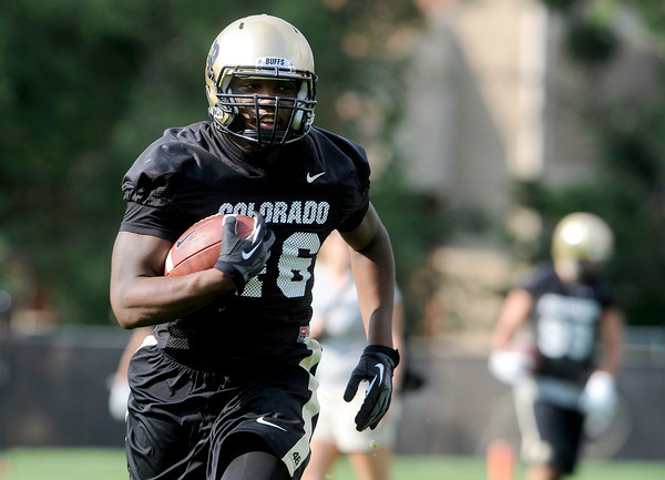 "University of Colorado's Christian Powell runs the ball during the second football practice of the fall camp on Tuesday, Aug. 7, at the CU practice field in Boulder. For more photos of the practice go to  <a href=""http://www.dailycamera.com"">http://www.dailycamera.com</a><br /> Jeremy Papasso/ Camera"