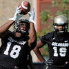 "University of Colorado's Donta Abron, No. 18, makes a catch in front of Davien Payne, No. 19, during the second football practice of the fall camp on Tuesday, Aug. 7, at the CU practice field in Boulder. For more photos of the practice go to  <a href=""http://www.dailycamera.com"">http://www.dailycamera.com</a><br /> Jeremy Papasso/ Camera"