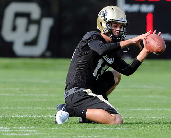 "University of Colorado's Zach Grossnickle catches a snap while holding for the place kickers during the second football practice of the fall camp on Tuesday, Aug. 7, at the CU practice field in Boulder. For more photos of the practice go to  <a href=""http://www.dailycamera.com"">http://www.dailycamera.com</a><br /> Jeremy Papasso/ Camera"
