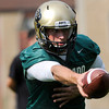 "University of Colorado quarterback Nick Hirschman hands the ball off to a running back during the second football practice of the fall camp on Tuesday, Aug. 7, at the CU practice field in Boulder. For more photos of the practice go to  <a href=""http://www.dailycamera.com"">http://www.dailycamera.com</a><br /> Jeremy Papasso/ Camera"