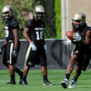 "University of Colorado's Gerald Thomas, right, makes a catch during the second football practice of the fall camp on Tuesday, Aug. 7, at the CU practice field in Boulder. For more photos of the practice go to  <a href=""http://www.dailycamera.com"">http://www.dailycamera.com</a><br /> Jeremy Papasso/ Camera"