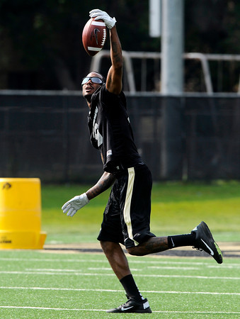 "University of Colorado receiver Paul Richardson makes a one-handed catch during the second football practice of the fall camp on Tuesday, Aug. 7, at the CU practice field in Boulder. Richardson is still recovering from a knee injury. For more photos of the practice go to  <a href=""http://www.dailycamera.com"">http://www.dailycamera.com</a><br /> Jeremy Papasso/ Camera"