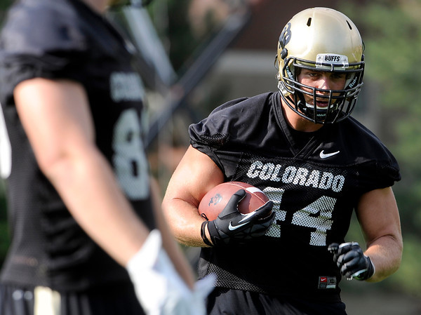 """University of Colorado's Nick Kasa runs the ball after making a catch during the second football practice of the fall camp on Tuesday, Aug. 7, at the CU practice field in Boulder. For more photos of the practice go to  <a href=""""http://www.dailycamera.com"""">http://www.dailycamera.com</a><br /> Jeremy Papasso/ Camera"""