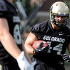 "University of Colorado's Nick Kasa runs the ball after making a catch during the second football practice of the fall camp on Tuesday, Aug. 7, at the CU practice field in Boulder. For more photos of the practice go to  <a href=""http://www.dailycamera.com"">http://www.dailycamera.com</a><br /> Jeremy Papasso/ Camera"
