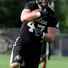"University of Colorado's Alex Wood runs the ball during the second football practice of the fall camp on Tuesday, Aug. 7, at the CU practice field in Boulder. For more photos of the practice go to  <a href=""http://www.dailycamera.com"">http://www.dailycamera.com</a><br /> Jeremy Papasso/ Camera"