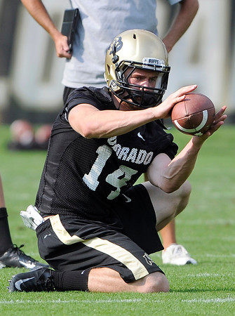 "University of Colorado's Justin Gorman catches a snap while holding for the kickers during the second football practice of the fall camp on Tuesday, Aug. 7, at the CU practice field in Boulder. For more photos of the practice go to  <a href=""http://www.dailycamera.com"">http://www.dailycamera.com</a><br /> Jeremy Papasso/ Camera"