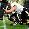 "University of Colorado's Will Pericak hits the sled on Monday, April 2, during spring football practice at the CU practice field on campus in Boulder. For more photos of practice go to  <a href=""http://www.dailycamera.com"">http://www.dailycamera.com</a><br />  Jeremy Papasso/ Camera"