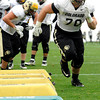 "University of Colorado's Eric Richter, No. 70, runs a drill on Monday, April 2, during spring football practice at the CU practice field on campus in Boulder. For more photos of practice go to  <a href=""http://www.dailycamera.com"">http://www.dailycamera.com</a><br />  Jeremy Papasso/ Camera"