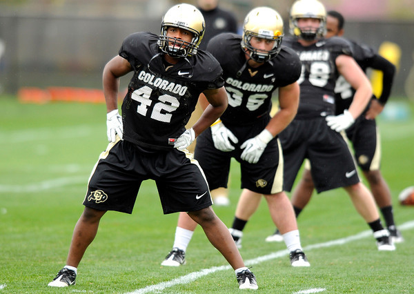 "University of Colorado's K.T. Tu'umalo stretches with his team on Monday, April 2, during spring football practice at the CU practice field on campus in Boulder. For more photos of practice go to  <a href=""http://www.dailycamera.com"">http://www.dailycamera.com</a><br />  Jeremy Papasso/ Camera"