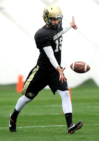 "University of Colorado's Zach Grossnickie practices punting on Monday, April 2, during spring football practice at the CU practice field on campus in Boulder. For more photos of practice go to  <a href=""http://www.dailycamera.com"">http://www.dailycamera.com</a><br />  Jeremy Papasso/ Camera"