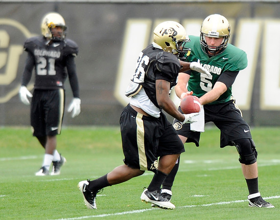 "University of Colorado's Connor Wood hands the ball off to Tony Jones on Monday, April 2, during spring football practice at the CU practice field on campus in Boulder. For more photos of practice go to  <a href=""http://www.dailycamera.com"">http://www.dailycamera.com</a><br />  Jeremy Papasso/ Camera"