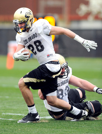 "University of Colorado's Will Harlos breaks a tackle from Will Pericak, No. 83, on Monday, April 2, during spring football practice at the CU practice field on campus in Boulder. For more photos of practice go to  <a href=""http://www.dailycamera.com"">http://www.dailycamera.com</a><br />  Jeremy Papasso/ Camera"