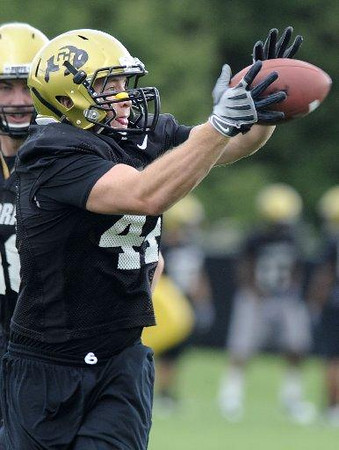 Fullback Trace Adams catches the ball during drills at practice on Saturday, Aug. 15, 2009 at the CU practice fields. Photo by Mara Auster/Daily Camera