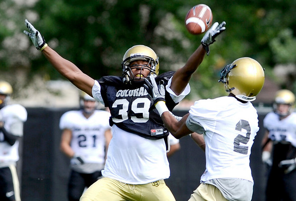 University of Colorado's Josh Moten (left) covers Travon Patterson (right) during football practice in Boulder, Colorado August 9, 2010.  CAMERA/Mark Leffingwell