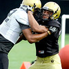 University of Colorado's Terrel Smith (right) is blocked by Jarrod Darden (left) during football practice in Boulder, Colorado August 9, 2010.  CAMERA/Mark Leffingwell