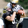 University of Colorado's Cameron Ham (left) knocks the ball from Dustin Ebner (right) during football practice in Boulder, Colorado August 9, 2010.  CAMERA/Mark Leffingwell