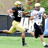 University of Colorado's Ray Polk (left) catches Tyler Hansen (right) after Hansen's 50 yard run during football practice in Boulder, Colorado August 9, 2010.  CAMERA/Mark Leffingwell